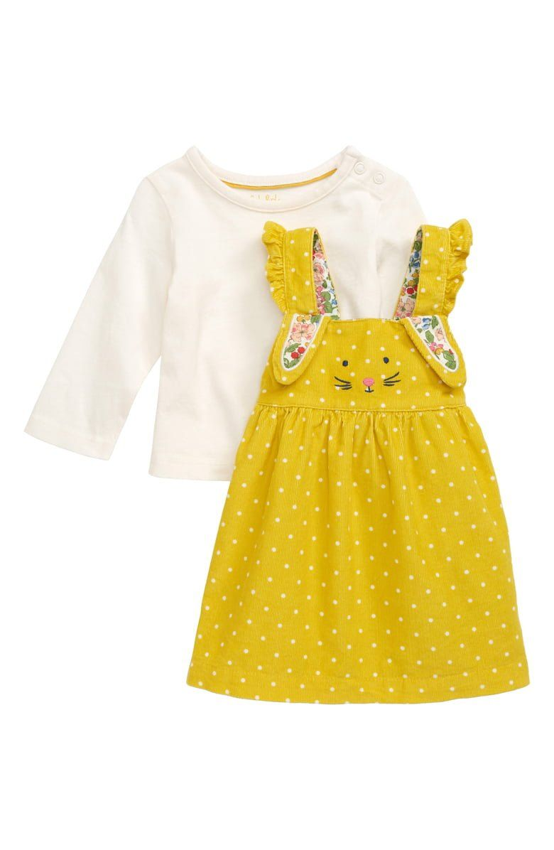 Sweet polka dots pepper a cotton corduroy pinafore embellished with a darling embroidered bunny face and floral-patterned ears. An essential long-sleeve T-shirt makes layering a breeze as the seasons change.