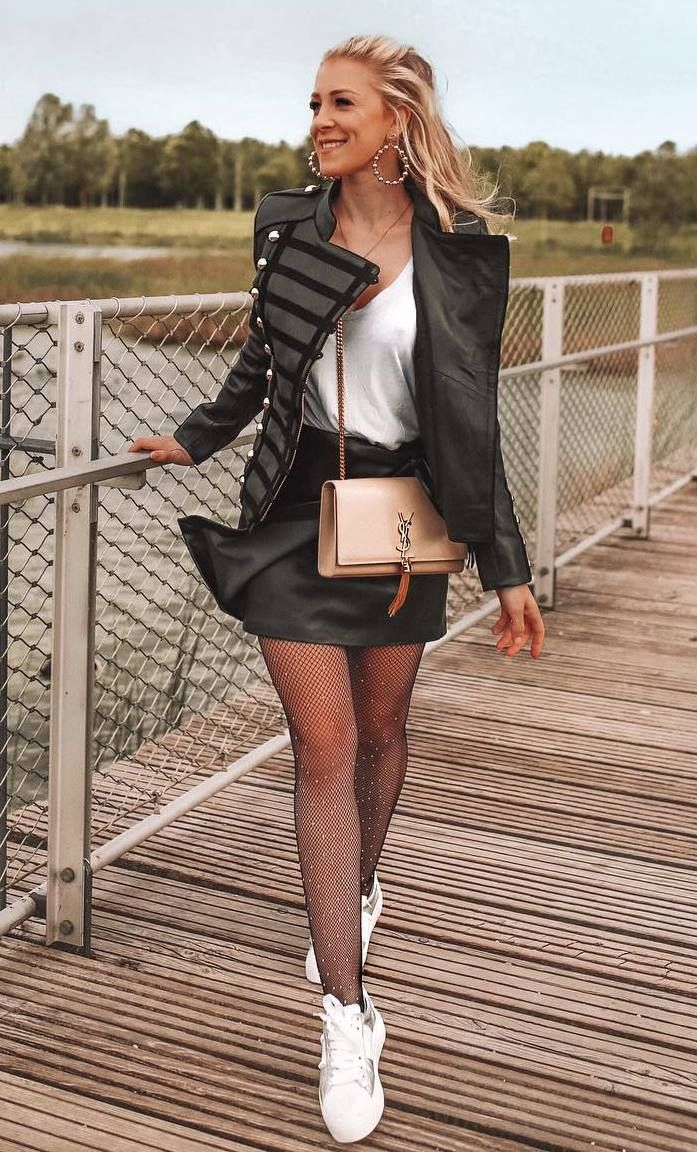 how to wear a leather skirt : white top + crossbody bag + sneakers