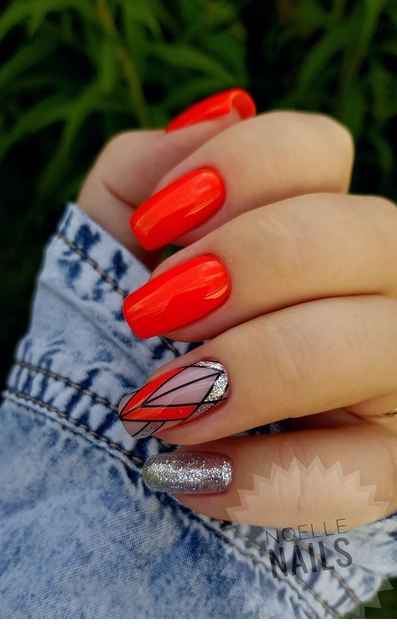 Bright red gel nails with geometric print