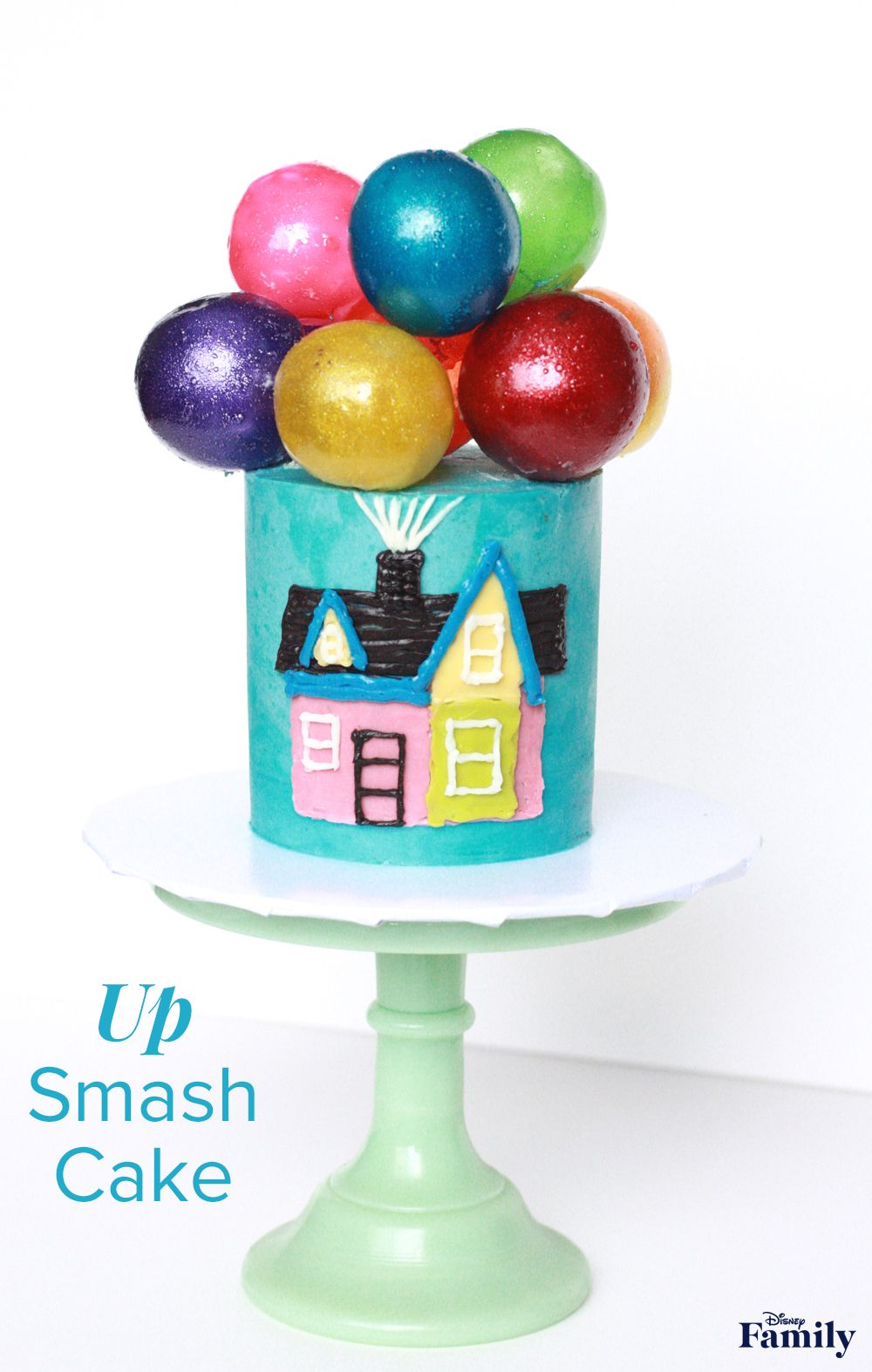 Watch as this 'Up'Smash Cake takes flight with edible balloon toppers made from just a few ingredients. Your little birthday boy or girl will love diving into this sweet treat—while the whole family cheers them on at their birthday party. Click for the Disney•Pixar smash cake recipe.