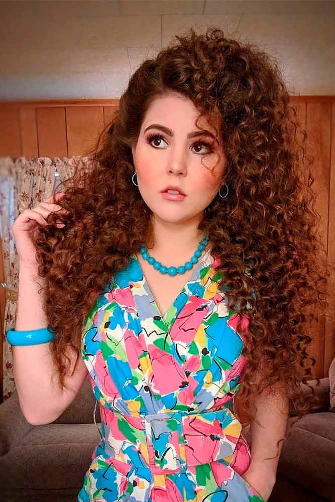 The Curly Blowout #longhair #curlyhairstyles #retrohairstyles ★ Luckily for retro-lovers, 80s hair is the new black! So how about you to refresh your memory and start rocking one of the biggest trends of now and then? Our long crimped styles, ponytail half up ideas, and voluminous curly looks with high bangs are here to inspire you! #glaminati #lifestyle #80shair