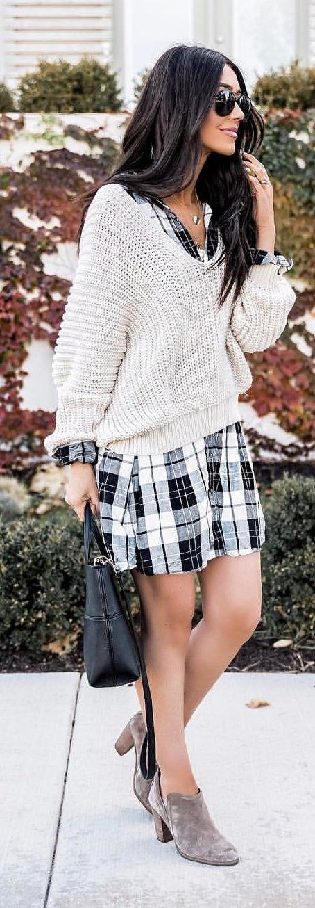 white sweater and black and white plaid skirt
