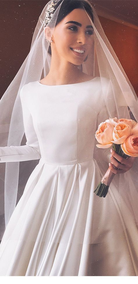 Simple wedding dress with orange flowers