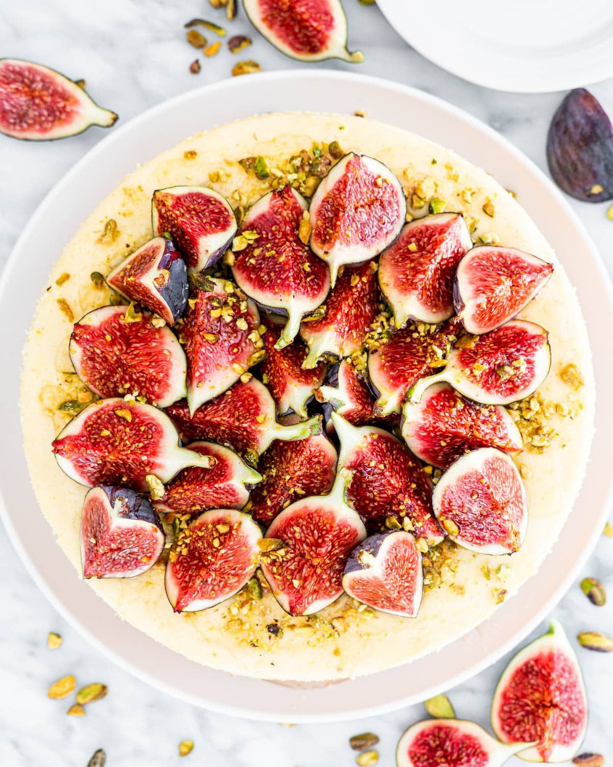 Goat Cheese Cheesecake with Figs, Pistachios and Honey - A perfect combination of fresh figs and creamy cheesecake, drizzled with honey, drool worthy! #goatcheese #cheesecake #figs #honey