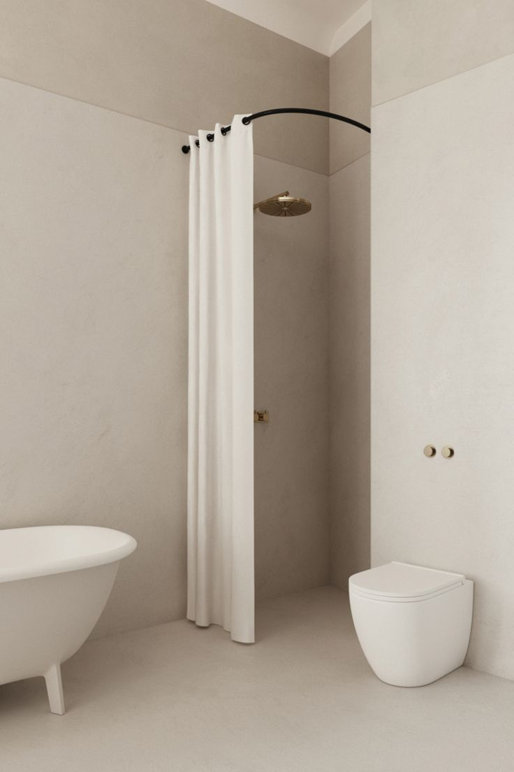 Minimal Warm Neutral Tiled Bathroom