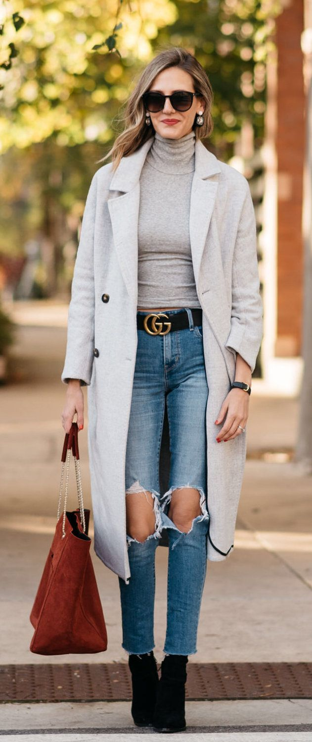 grey overcoat and blue jeans