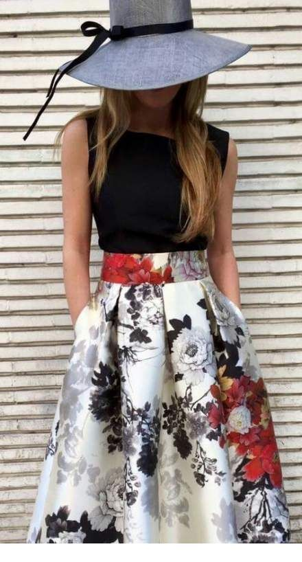 Black top, printed skirt and a hat