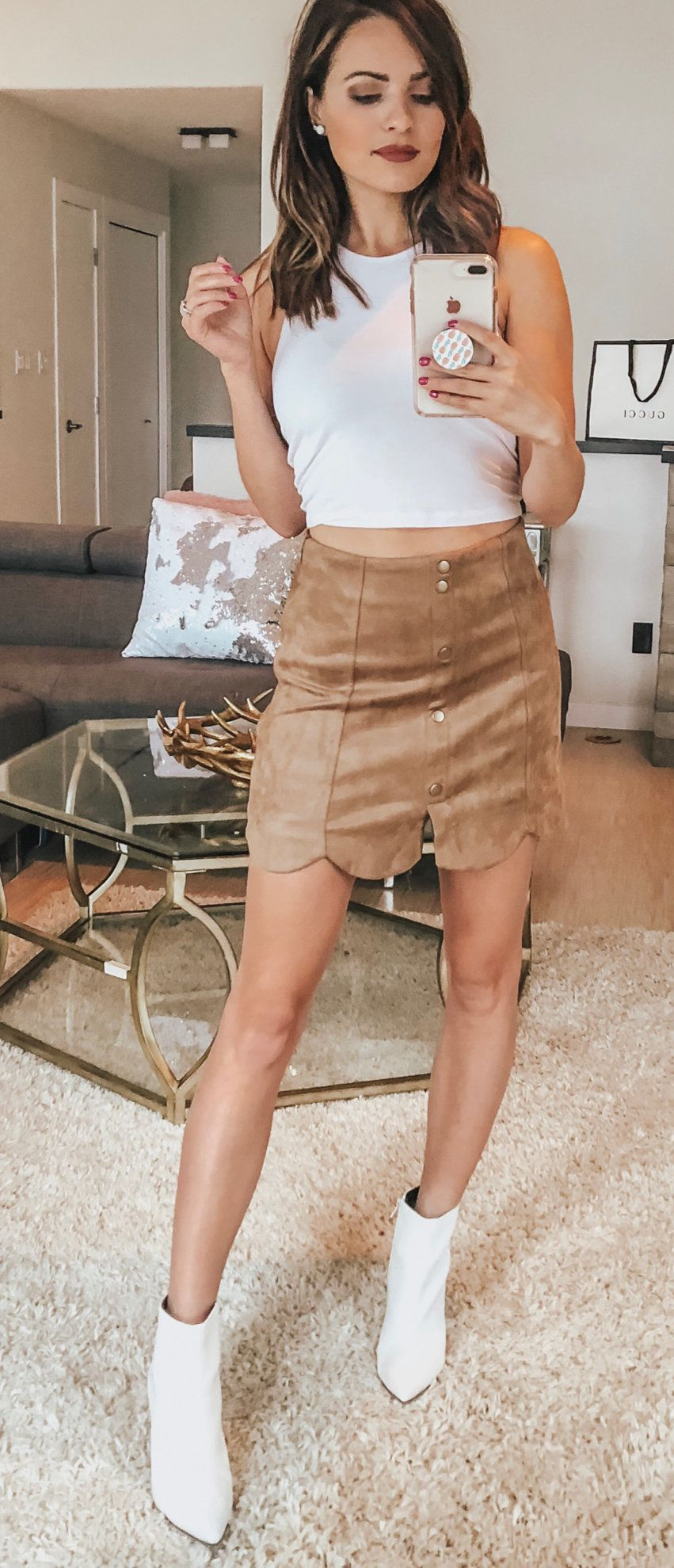 white crop top and brown leather skirt