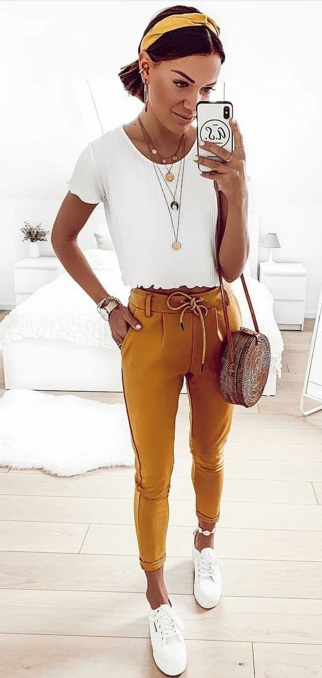 white scoop-neck cap-sleeved crop top and brown boyfriend jean #spring #outfits