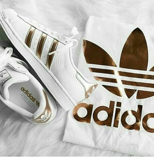 White sport shoes and t-shirt by Adidas