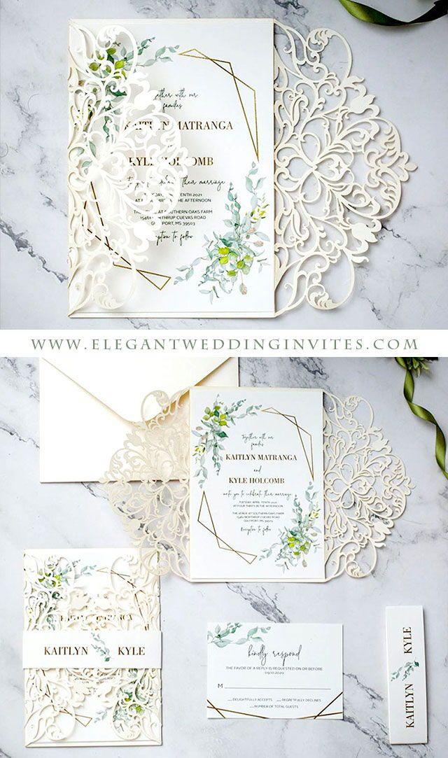 elegant ivory laser cut wedding invitation with greenery pattern around framed wording EWDM015 as lo