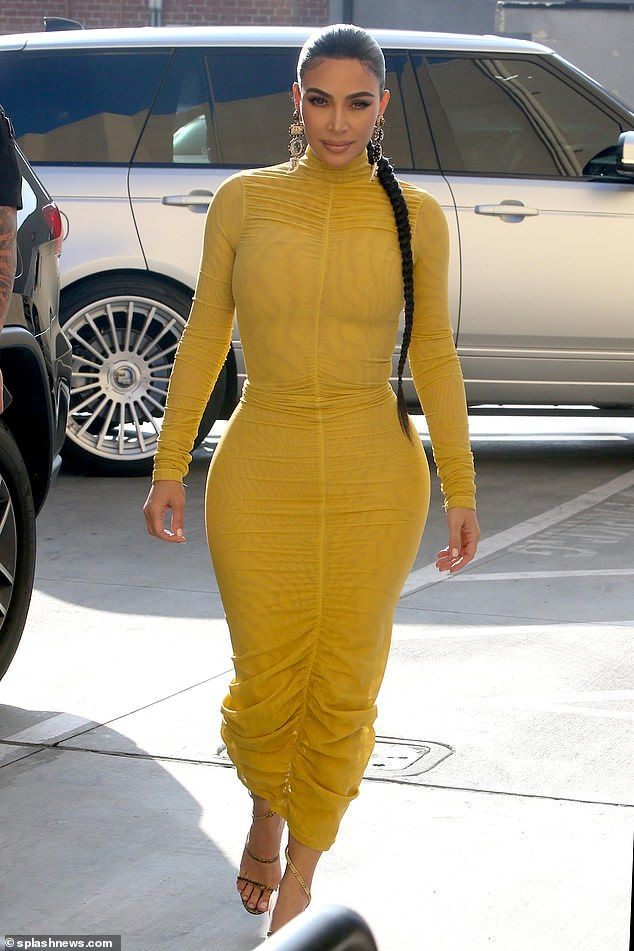 Ray of sunshine!Kim Kardashian commanded attention as she made her way into the studio to...
