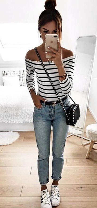 white and black striped off-shoulder long-sleeved shirt and blue denim jeans #spring #outfits