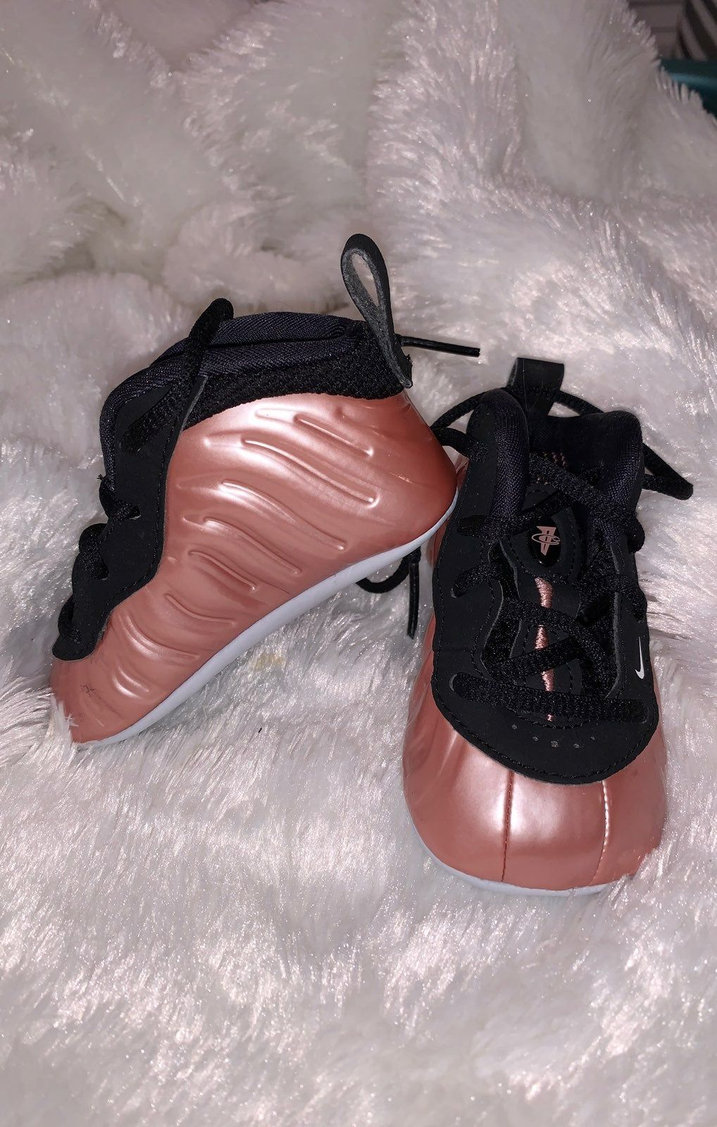 pink nike foamposites more-so of a rose gold color size: 3c worn once times