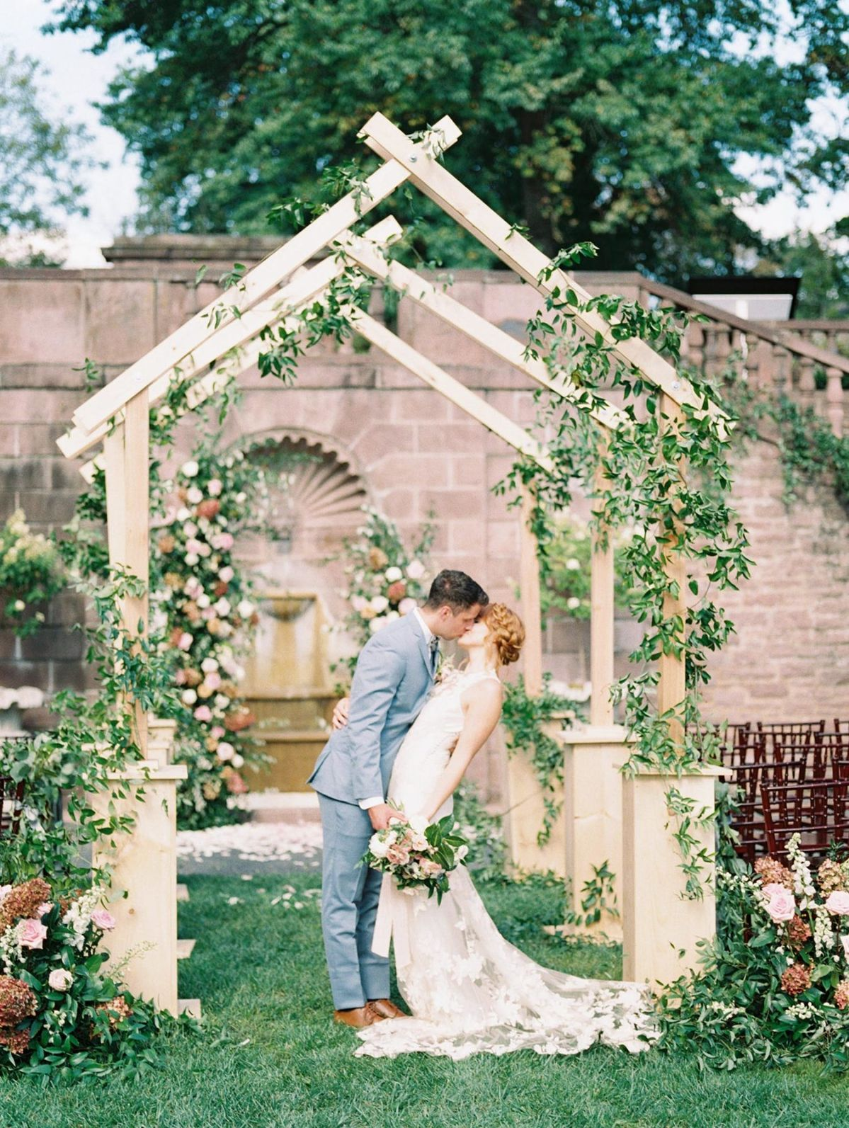 Is this elegant garden wedding in France or Philadelphia? We are hopelessly devoted to summer to autumn color palette in the curvy floral pillars, the French dessert cart and the custom aisle arch structure featuring climbing greenery! Floral inspiration abounds in every inch of this outdoor bridal inspo from our latest Styled Social and we cannot wait to share all the beauty with you on #ruffledblog!