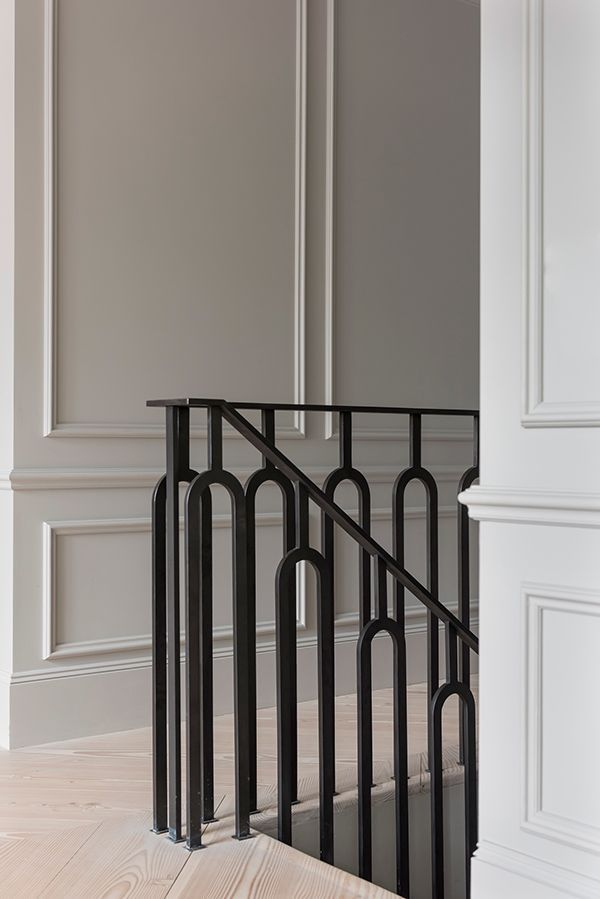Black curved metal stair bannister