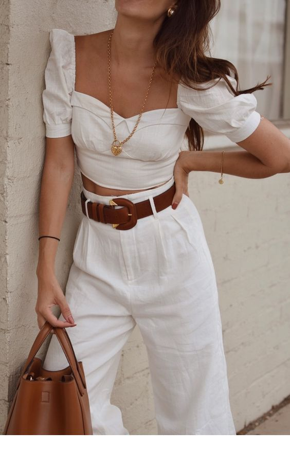 White blouse and pants with many accessories