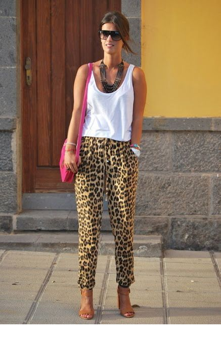 White top, leo pants and pink bag