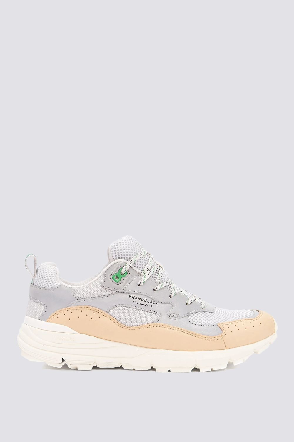Inspired by classic trainers, the Nomo blends trail ready functionality with quality materials. Set on a chunky Vibram® sole, the upper is constructed with almond leather, mesh and reflective paneling for high visibility. Includes contrast lacing and bold eyelets. *All sizes are listed in Unisex. Women's sizes are 1.5