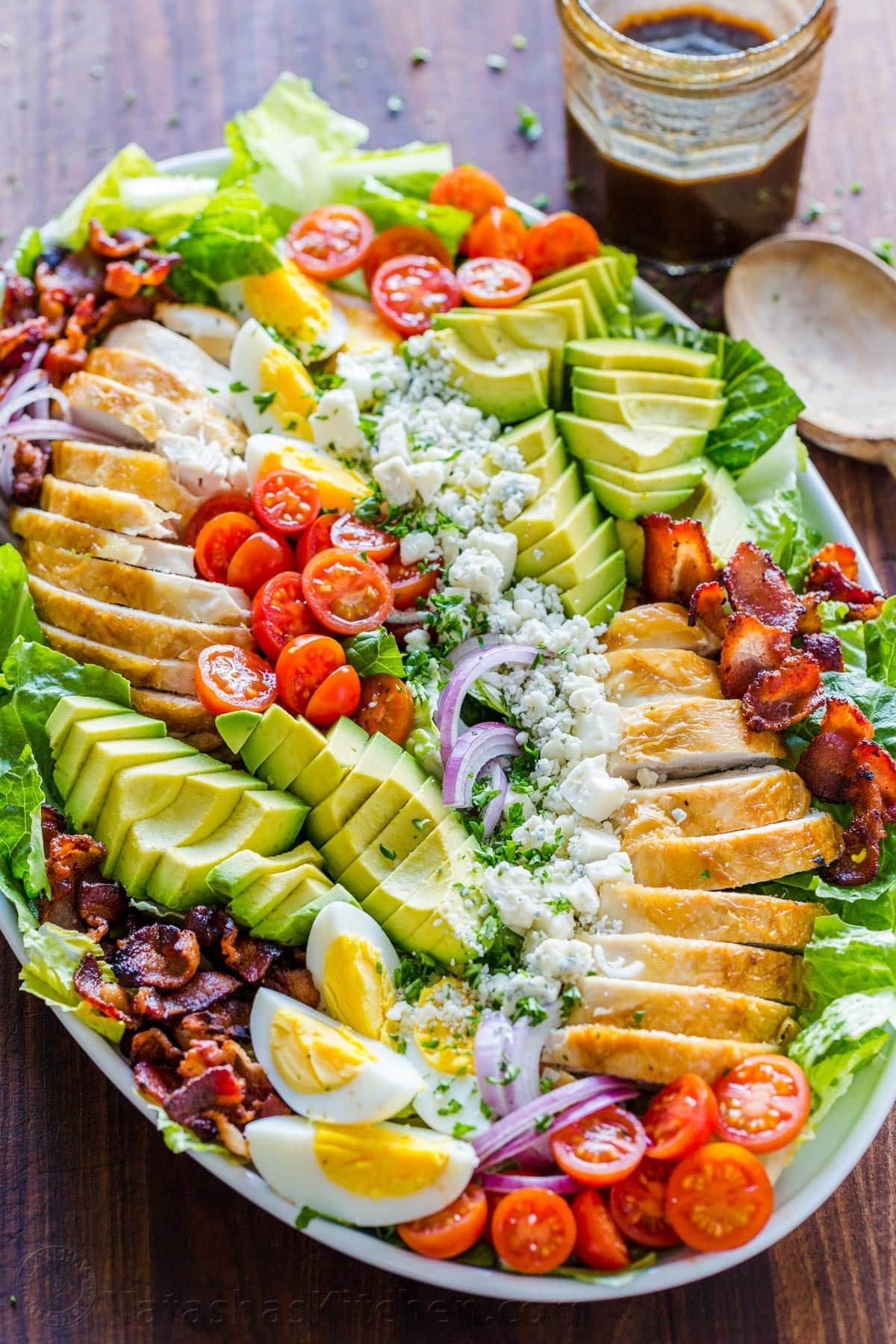 Easy Chicken Cobb Salad with the Best Cobb Salad Dressing! A protein-packed salad loaded with crisp lettuce, tomatoes, chicken, avocado and blue cheese. #cobbsalad #cobbsaladrecipe #easycobbsalad #bestcobbsalad #saladrecipes #salad #natashaskitchen
