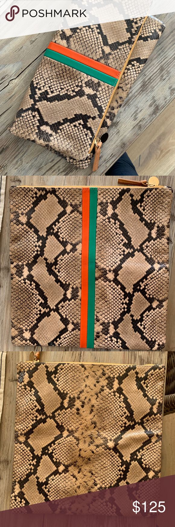 "Clare V. Snake Skin Clutch Clare V. Flodover Clutch.  Spring Snake Nappa Desert   New, never used Dimensions: 11.5""L x 11.5""W Lined in chambray Marigold zipper No interior compartments or pockets Holds a smartphone, small wallet, keys with a little room to spare Green & Orange inlaid stripes are made from drum dyed Italian lambskin that is smooth and vibrant in color Tan Spring Snake is made from embossed cowhide.  Embossed leather can be wiped with a damp cloth but only very gently to maintai"
