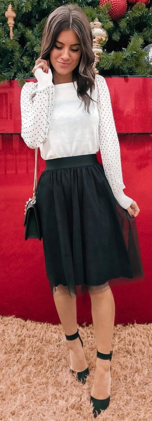 white long-sleeved shirt and black midi skirt