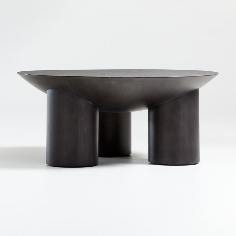 Shop Tom Charcoal Three-Legged Coffee Table. Our conversation-sparking Tom coffee table delights with unexpected proportions and playful geometry. Oversized cylinders stand in for slender table legs, supporting a top that looks like a slice of a giant sphere.