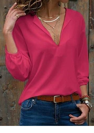 Cute pink blouse and blue jeans