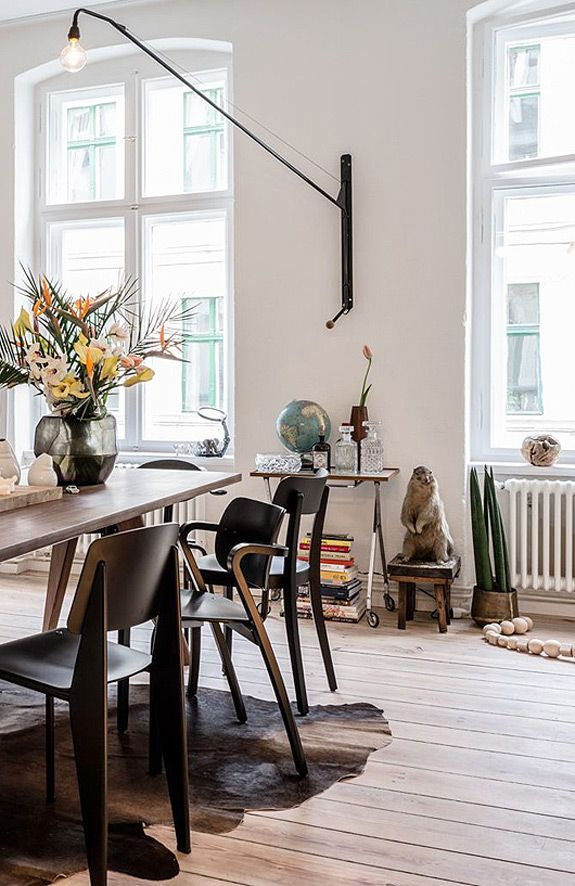 eclectic dining room with wood table and chairs. / sfgirlbybay
