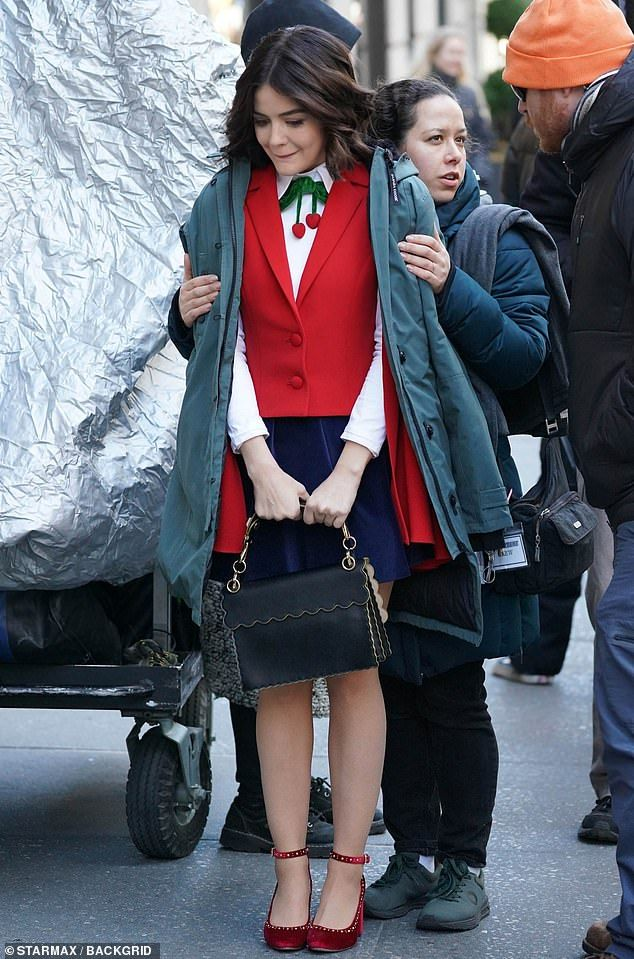 Chilly: While filming, Lucy did her best to keep warm in between takes, adding another coat to her outfit