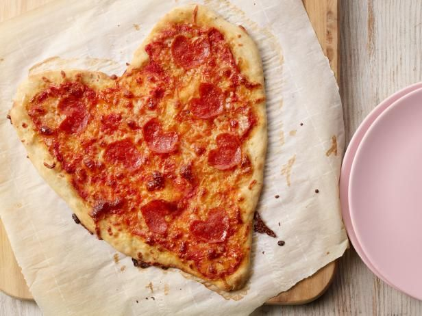 Recipe of the Day: Heart-Shaped Pizza for Two | With a few little tricks, you can transform a regular pepperoni pizza into a special heart-shaped treat. We take a few shortcuts, like store-bought pizza dough and sauce, so that it comes together quickly, but don't worry: We won't tell anyone it wasn't a labor of love.