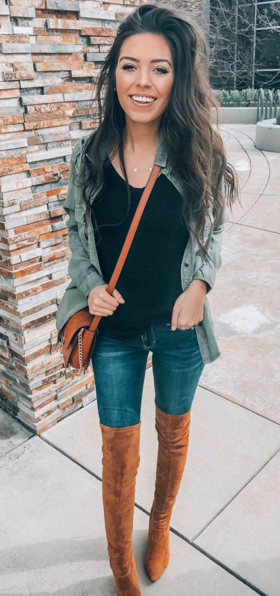 black tank top, gray denim button-up jacket, and blue denim fitted jeans #spring #outfits