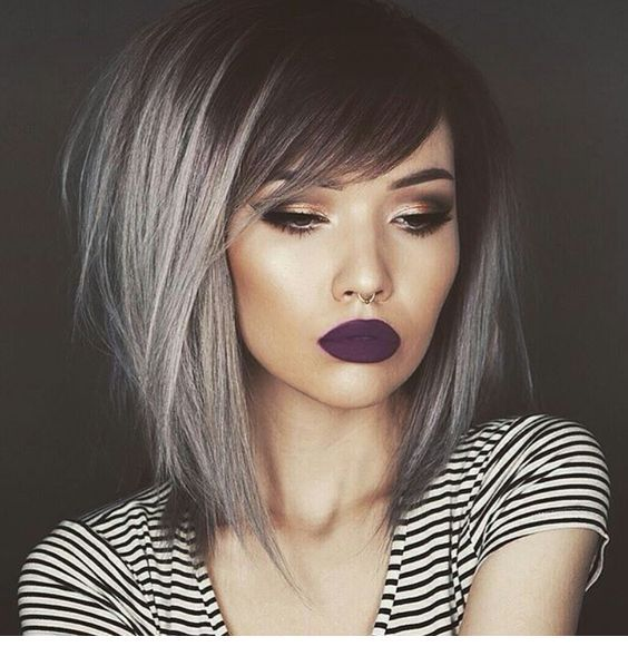 Grey hair and purple lips