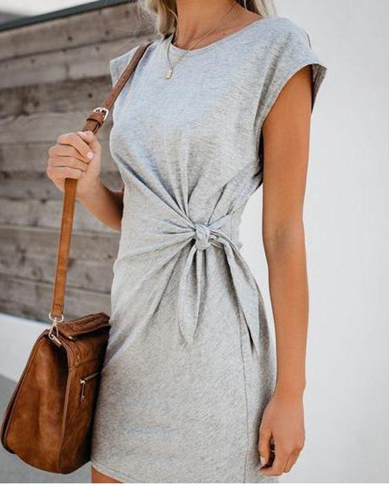 Grey dress and brown bag