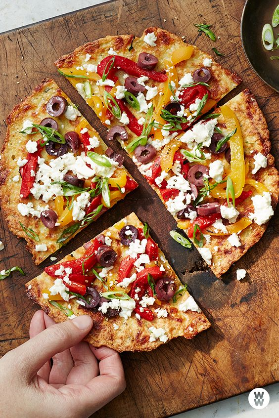 Cauliflower crust pizza with feta, peppers, and olives: Rice-like pieces of cauliflower make a tender crust. We went Greek with the seasonings and toppings, but tomatoes, part-skim mozzarella and reduced-fat pesto would also be delicious.