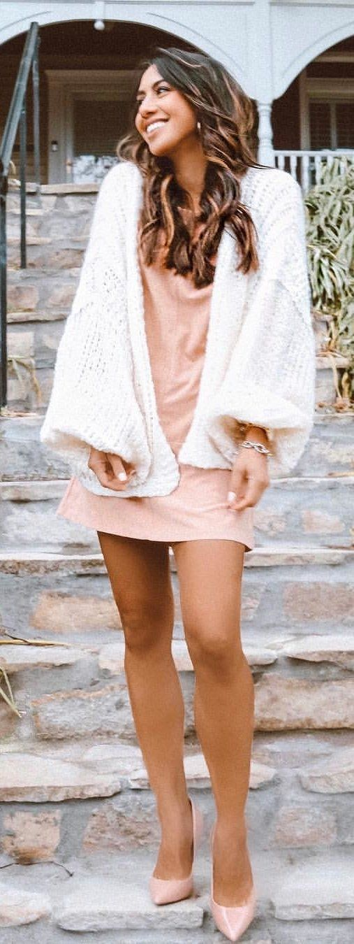 white blazer, nude-colored mini dress, and pair of shoes