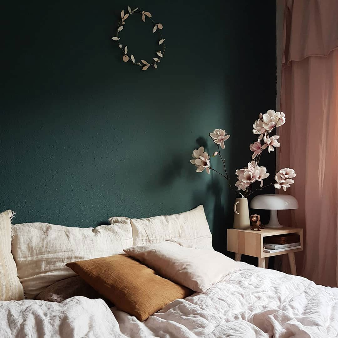 green bedroom wall with pink curtains. / sfgirlbybay