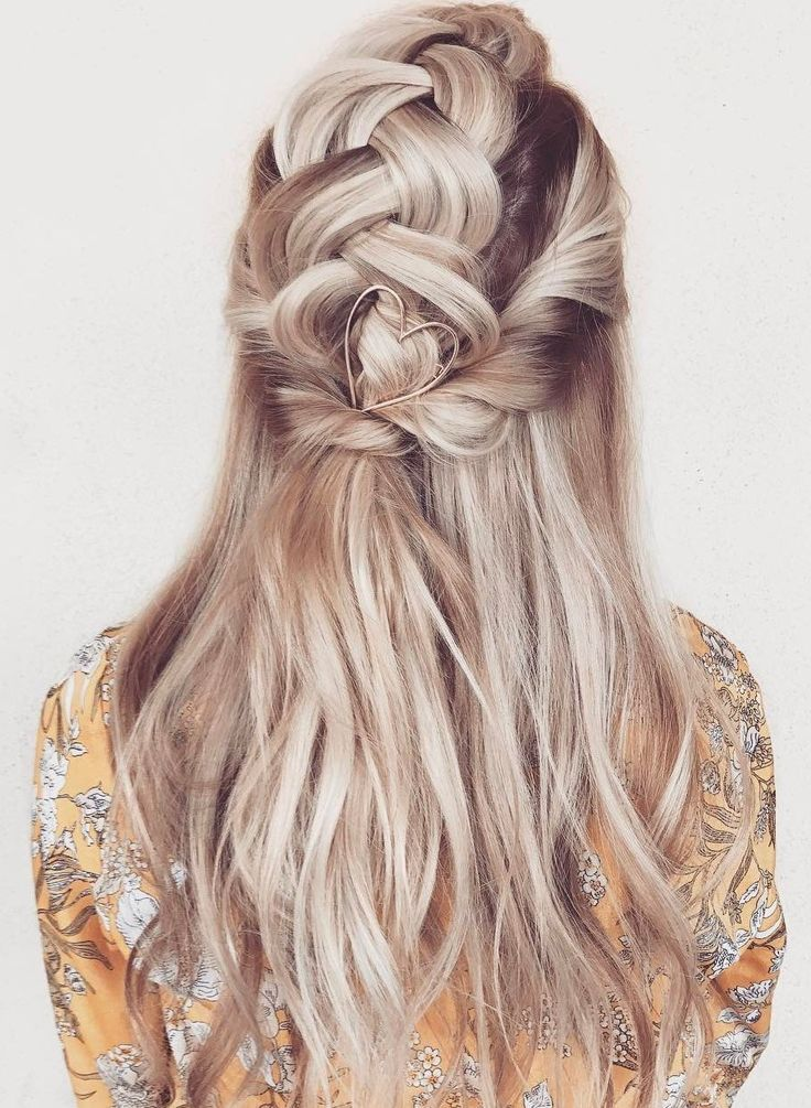 loving this pretty braided half up hairstyle with the funky heart barette