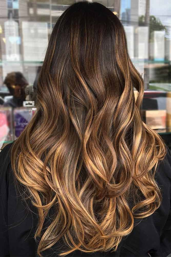 Dark brown hair is beating all the charts these days. And there is no wonder why, as all these hues of brown are so versatile that it is difficult not to fall in love with them. Besides, highlights for dark brown hair are in no case lagging behind. The ch