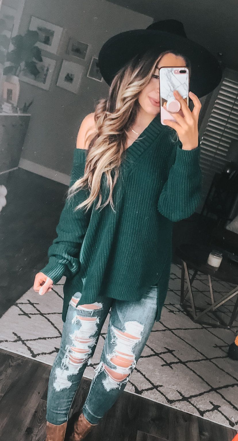 green V-neck knit sweater