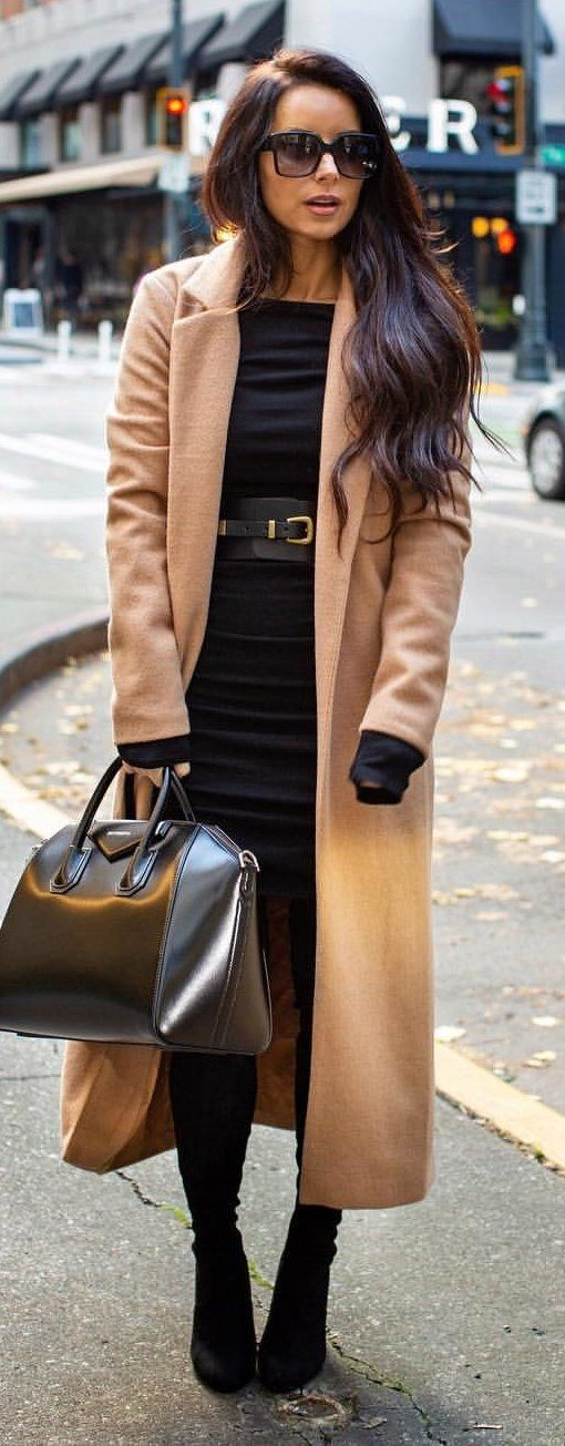 brown cardigan and black leather handbag