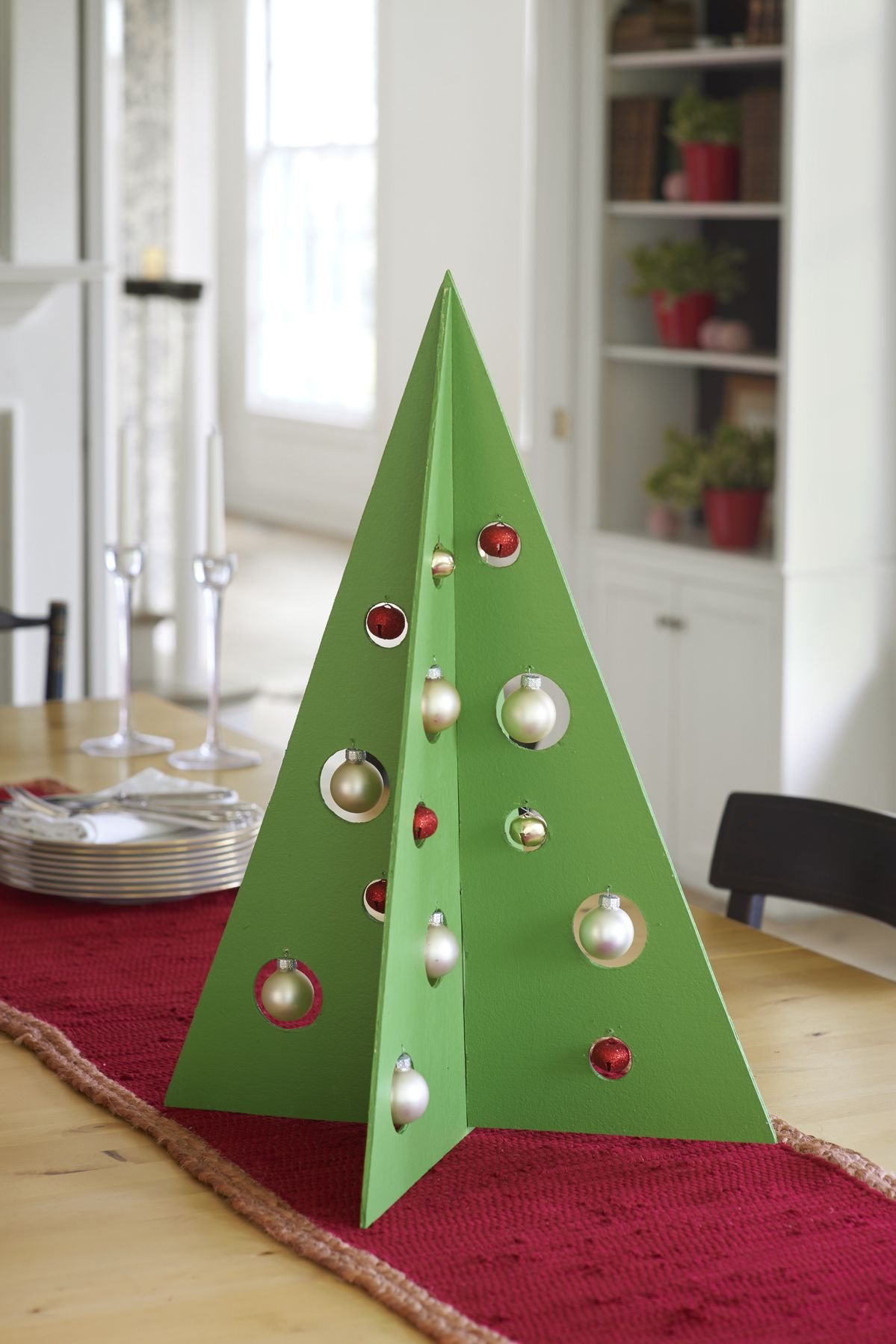 Here's a truly evergreen centerpiece: This modern take on a festive fir won't wilt, doesn't need watering, and can be stored flat, then hauled out season after season.