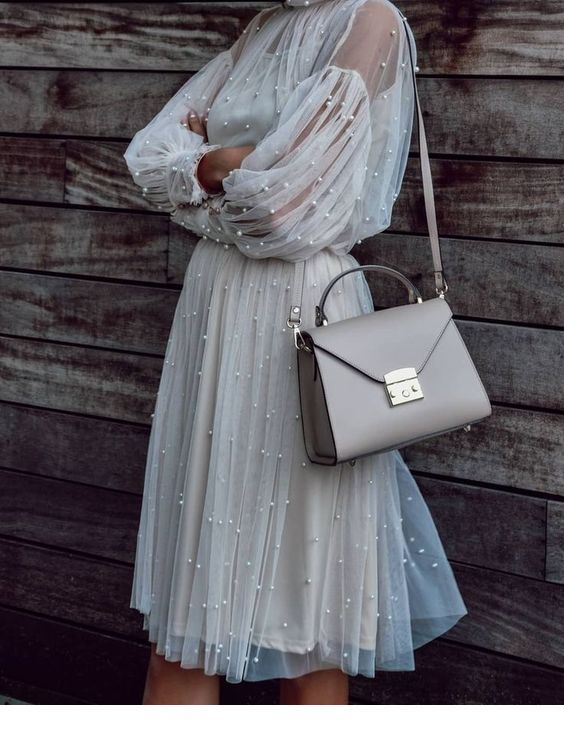 Sweet dress with pearls and a grey bag