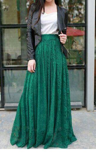 White top, long green skirt and black leather jacket