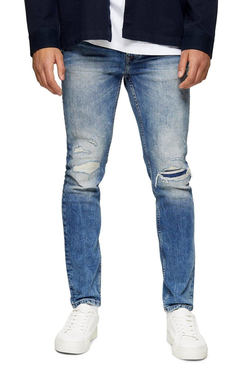 Achieve street-ready perfection in these faded, slim-fitting jeans finished with edgy, reinforced rips.