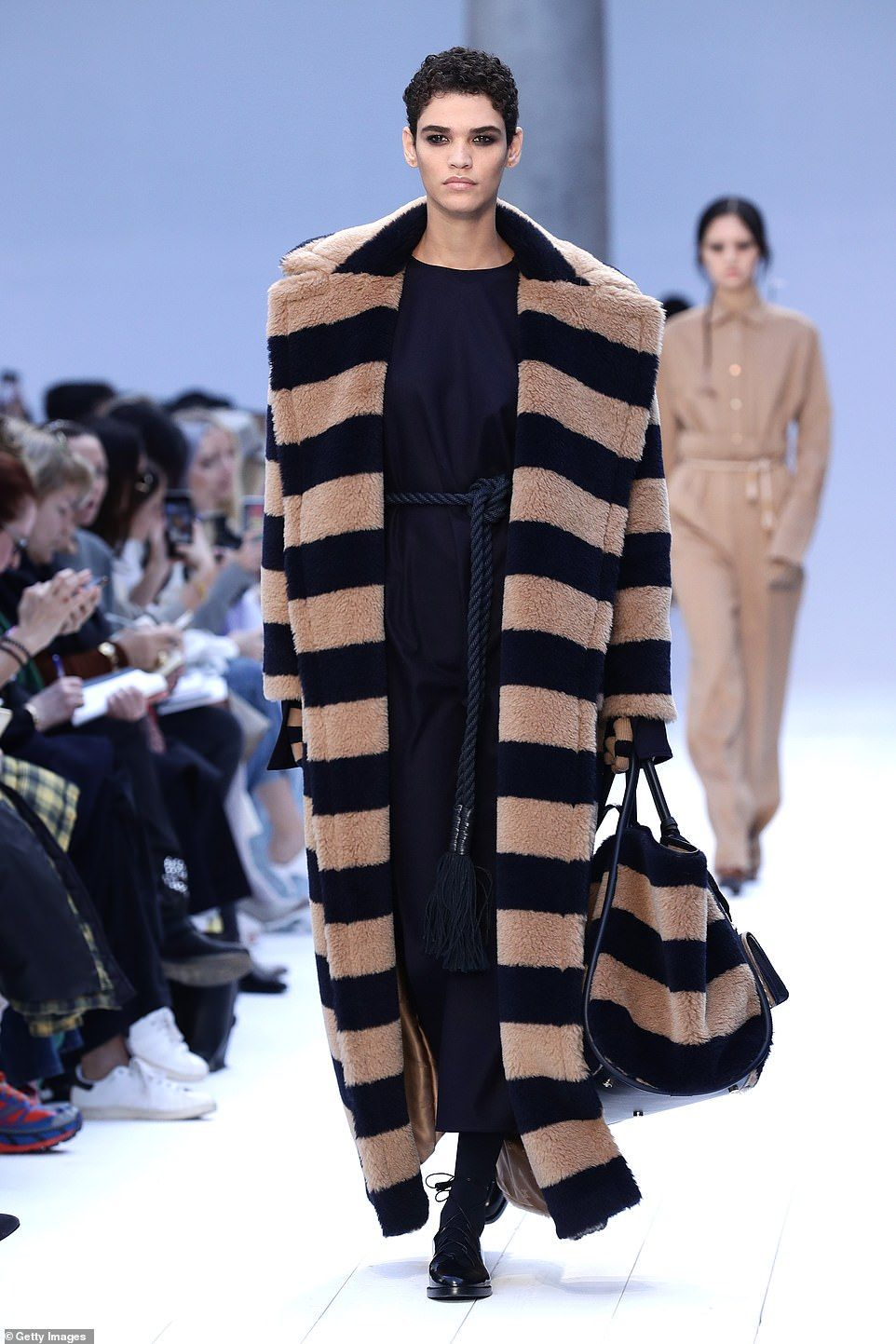 Strutting their stuff:The runway was awash with navy and white hues, with a peppering of ...