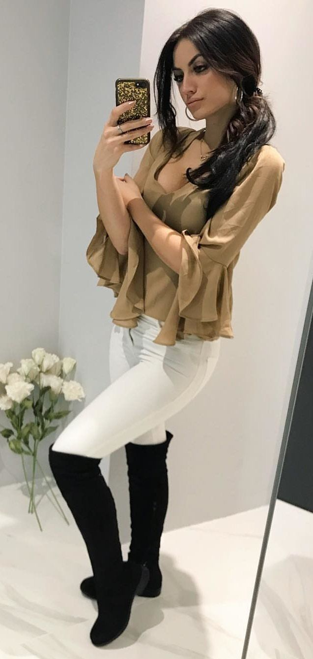 brown trumpet-sleeved top, white pants, and pair of black boots outfit #spring #outfits