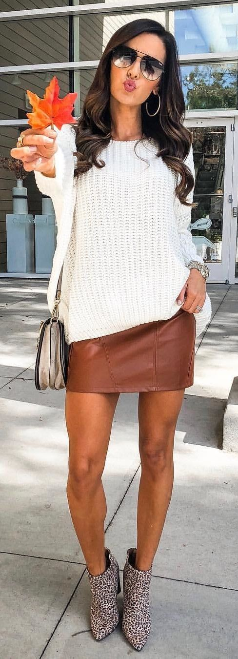 white sweater and brown skirt