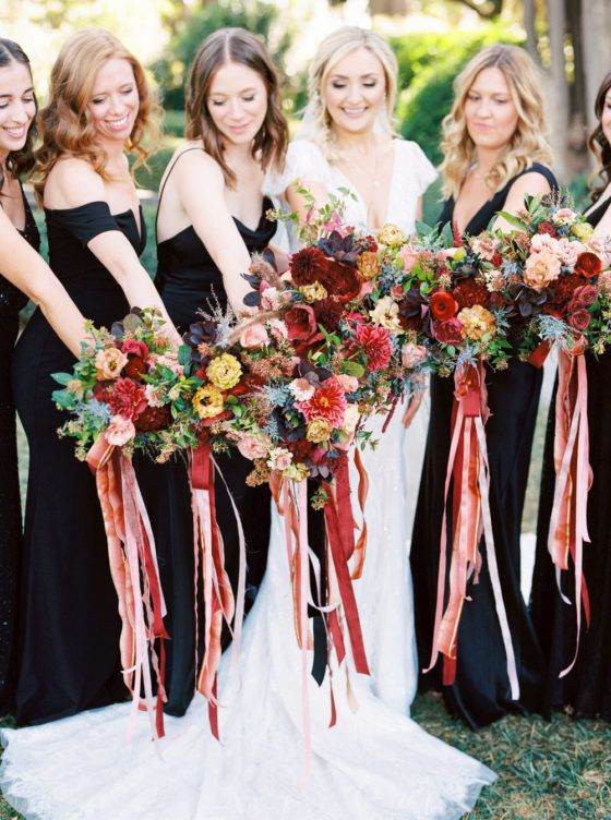 An al fresco black tie wedding in Northern California is just as dreamy as it sounds! Jocelyn and Andrew said I do in a garden wedding bursting with a jewel-toned color palette planned by Steele My Heart. Our hearts are bursting over the red wine dahlias, pink velvet linens, and the Disney inspired table numbers perfectly captured by Ashley Baumgartner. We may be scrolling through in our pajamas but this black tie affair has us feeling like 24k gold! View full post >>