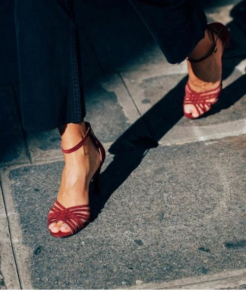 Jeans and red sandals